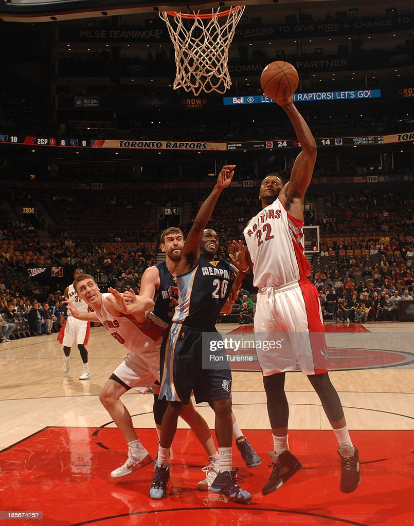 <a gi-track='captionPersonalityLinkClicked' href=/galleries/search?phrase=Rudy+Gay&family=editorial&specificpeople=236066 ng-click='$event.stopPropagation()'>Rudy Gay</a> #22 of the Toronto Raptors shoots the ball against <a gi-track='captionPersonalityLinkClicked' href=/galleries/search?phrase=Quincy+Pondexter&family=editorial&specificpeople=4176540 ng-click='$event.stopPropagation()'>Quincy Pondexter</a> #20 of the Memphis Grizzlies during the game on October 23, 2013 at the Air Canada Centre in Toronto, Ontario, Canada.