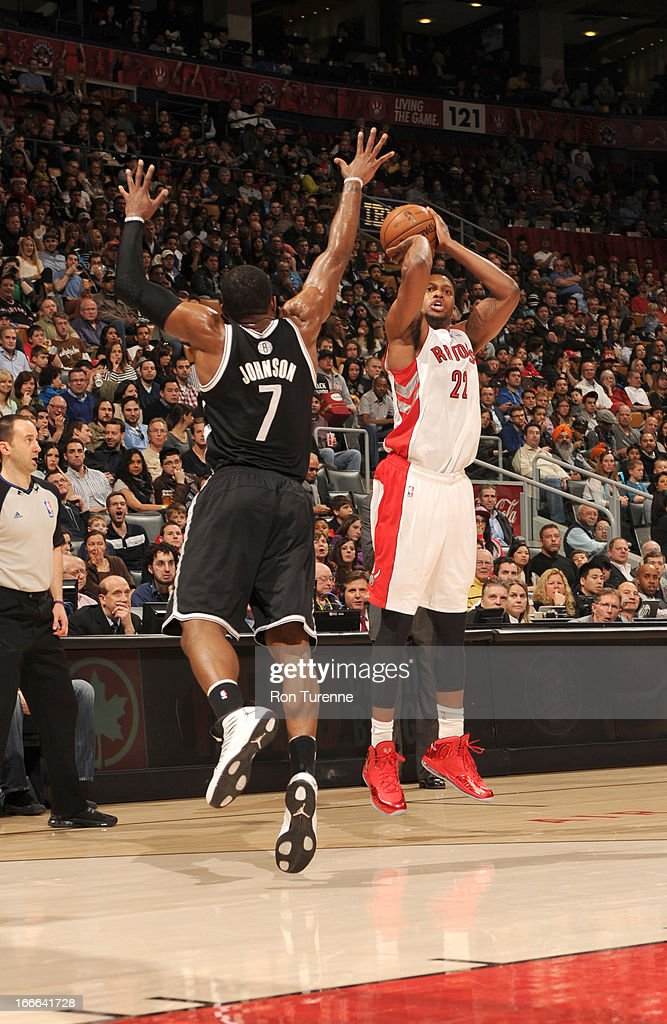 Rudy Gay #22 of the Toronto Raptors shoots the ball over Joe Johnson #7 of the Brooklyn Nets during the game between the Toronto Raptors and the Brooklyn Nets on April 14, 2013 at the Air Canada Centre in Toronto, Ontario, Canada.