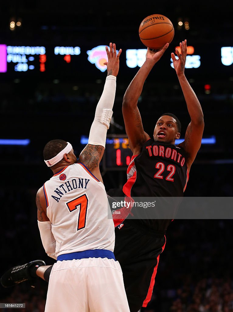 Rudy Gay #22 of the Toronto Raptors takes a shot as Carmelo Anthony #7 of the New York Knicks defends on February 13, 2013 at Madison Square Garden in New York City. The Toronto Raptors defeated the New York Knicks 92-88.