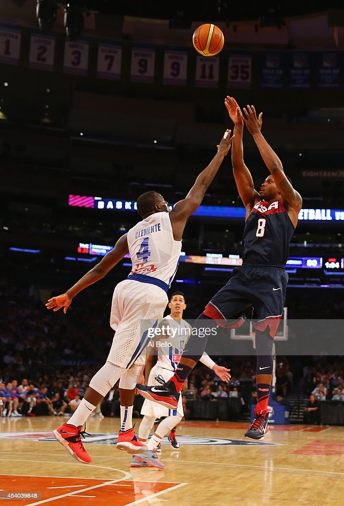 <a gi-track='captionPersonalityLinkClicked' href=/galleries/search?phrase=Rudy+Gay&family=editorial&specificpeople=236066 ng-click='$event.stopPropagation()'>Rudy Gay</a> #8 of the USA shoots against <a gi-track='captionPersonalityLinkClicked' href=/galleries/search?phrase=Jose+Barea&family=editorial&specificpeople=883866 ng-click='$event.stopPropagation()'>Jose Barea</a> #4 of Puerto Rico during their game at Madison Square Garden on August 22, 2014 in New York City.