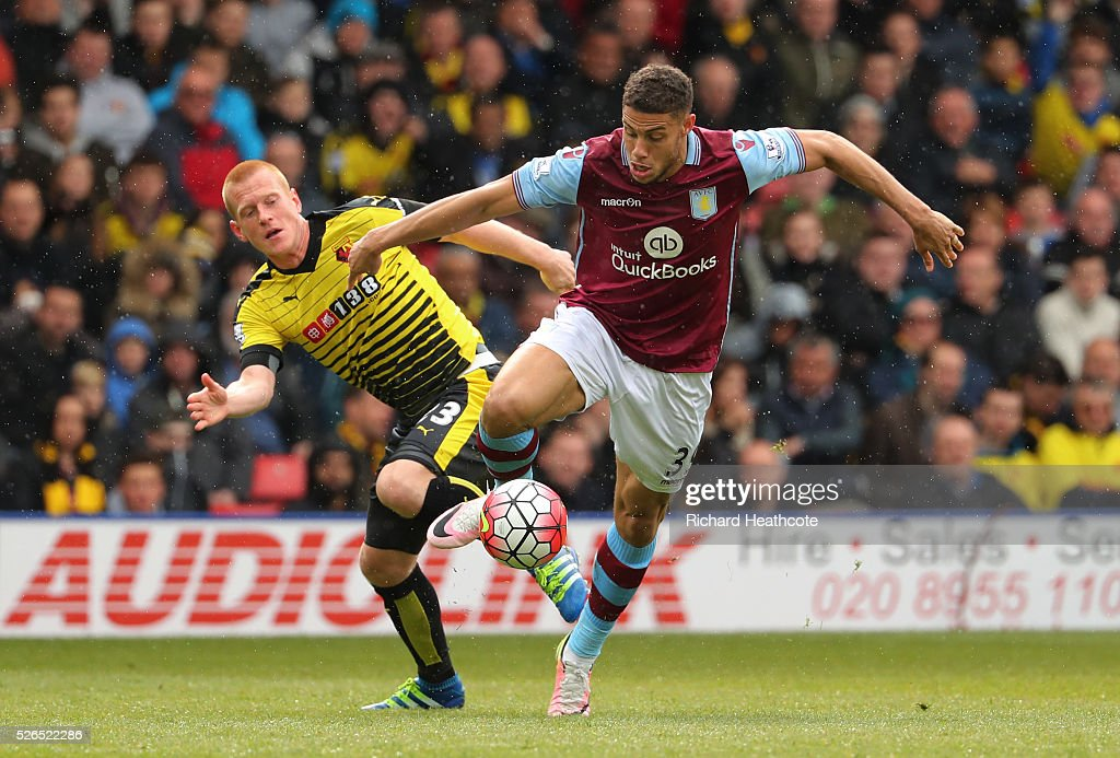 Rudy Gestede of Aston Villa and Ben Watson of Watford compete for the ball during the Barclays Premier League match between Watford and Aston Villa at Vicarage Road on April 30, 2016 in Watford, England.