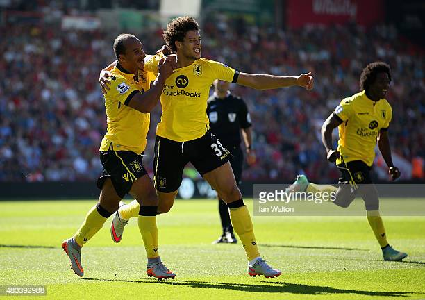 Rudy Gestede of Aston Villa celebrates scoring his team's first goal with his team mates Gabriel Agbonlahor and Carlos Sanchez during the Barclays...