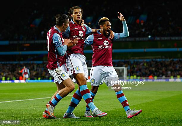 Rudy Gestede of Aston Villa celebrates scoring their first goal with Jack Grealish and Jordan Amavi of Aston Villa during the Capital One Cup third...