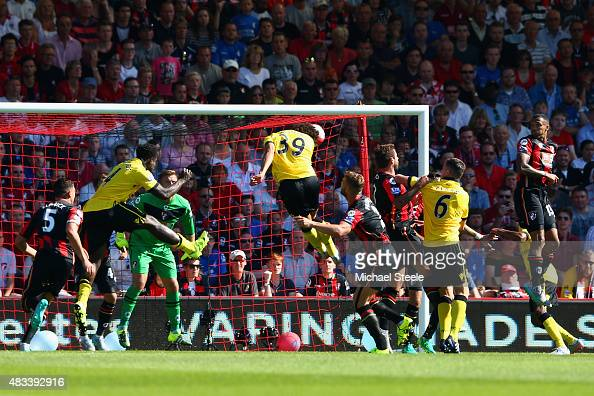 Rudy Gestede of Aston Villa scores his team's first goal with his team mate Carlos Sanchez during the Barclays Premier League match between AFC...