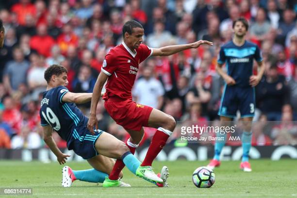 Rudy Gestede of Middlesbrough and Joel Matip of Liverpool during the Premier League match between Liverpool and Middlesbrough at Anfield on May 21...