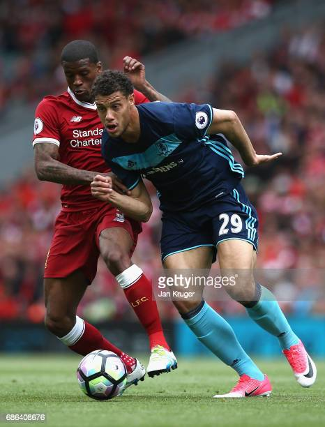 Rudy Gestede of Middlesbrough is put under pressure from Georginio Wijnaldum of Liverpool during the Premier League match between Liverpool and...