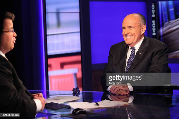 Rudy Giuliani talks with host Neil Cavuto on the set of 'Cavuto' on FOX Business Network at FOX Studios on September 23 2014 in New York City