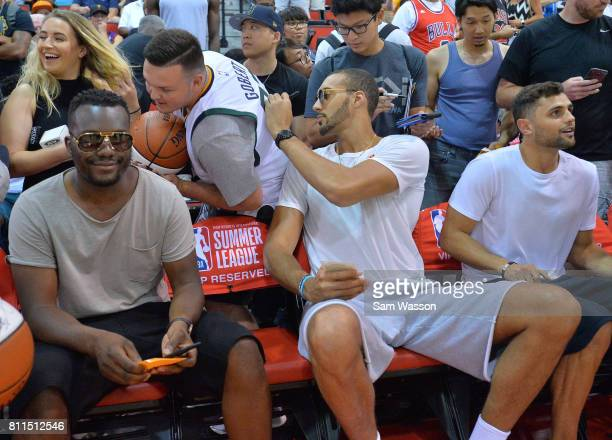 Rudy Gobert of the Utah Jazz signs autographs for fans during a game between the Utah Jazz and Los Angeles Clippers during the 2017 Summer League at...