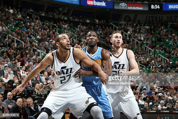 Rudy Gobert and Gordon Hayward of the Utah Jazz boxes out Kenneth Faried of the Denver Nuggets on November 23 2016 at vivintSmartHome Arena in Salt...