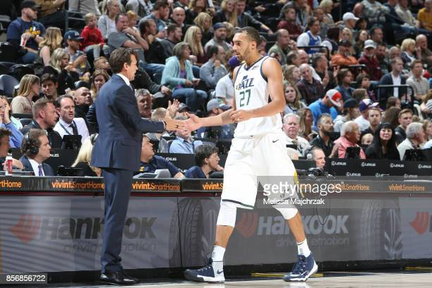 Rudy Gobert and Head Coach Quin Snyder of the Utah Jazz high five during a preseason game against the Sydney Kings on October 2 2017 at...
