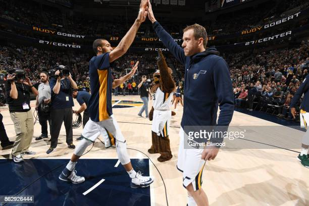 Rudy Gobert and Joe Ingles of the Utah Jazz give high fives before the game against the Denver Nuggets on October 18 2017 at vivintSmartHome Arena in...