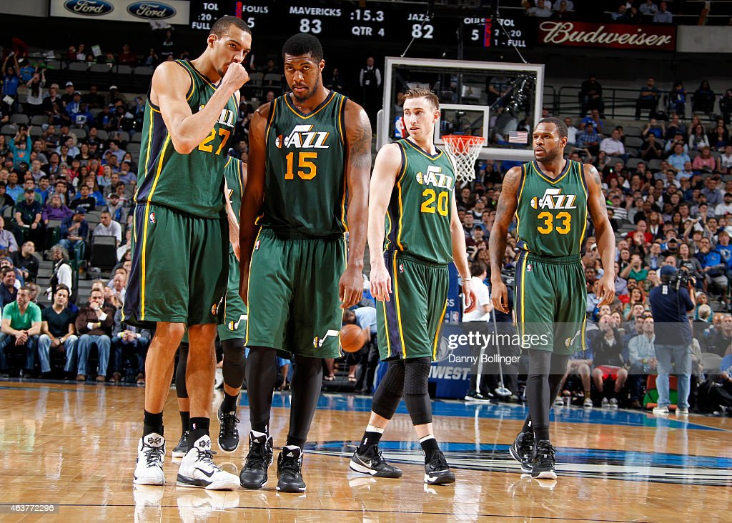 <a gi-track='captionPersonalityLinkClicked' href=/galleries/search?phrase=Rudy+Gobert&family=editorial&specificpeople=7616046 ng-click='$event.stopPropagation()'>Rudy Gobert</a> #27, <a gi-track='captionPersonalityLinkClicked' href=/galleries/search?phrase=Derrick+Favors&family=editorial&specificpeople=5792014 ng-click='$event.stopPropagation()'>Derrick Favors</a> #15, <a gi-track='captionPersonalityLinkClicked' href=/galleries/search?phrase=Gordon+Hayward&family=editorial&specificpeople=5767271 ng-click='$event.stopPropagation()'>Gordon Hayward</a> #20, and <a gi-track='captionPersonalityLinkClicked' href=/galleries/search?phrase=Trevor+Booker&family=editorial&specificpeople=4123563 ng-click='$event.stopPropagation()'>Trevor Booker</a> #33 of the Utah Jazz stand on the court during a game against the Dallas Mavericks on February 11, 2015 at the American Airlines Center in Dallas, Texas.