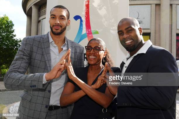 Rudy Gobert Marie Josee Perec and Teddy Riner poses during the visit of IOC Evaluation Commission Chairman Patrick Baumann after the press conference...