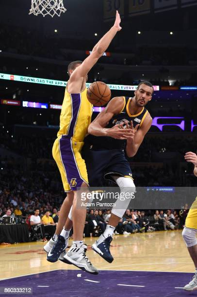 Rudy Gobert of the Utah Jazz and Brook Lopez of the Los Angeles Lakers vie for the ball during the preseason game on October 10 2017 at STAPLES...