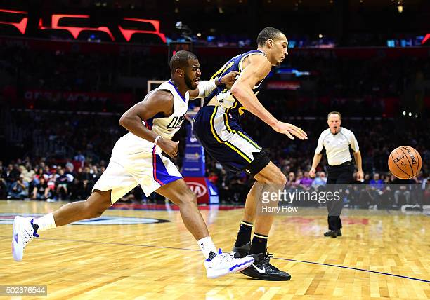 Rudy Gobert of the Utah Jazz and Chris Paul of the Los Angeles Clippers go after a loose ball at Staples Center on November 25 2015 in Los Angeles...