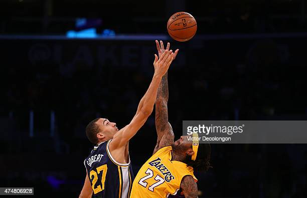 Rudy Gobert of the Utah Jazz and Jordan Hill of the Los Angeles Lakers take the opening tipoff during the NBA game at Staples Center on March 19 2015...