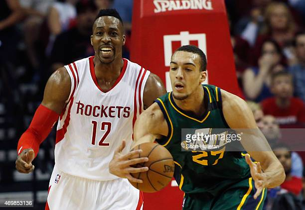 Rudy Gobert of the Utah Jazz battles for a loose basketball in front of Dwight Howard of the Houston Rockets during their game at the Toyota Center...