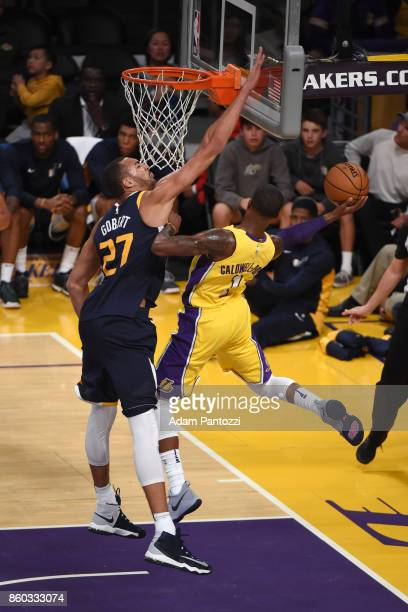 Rudy Gobert of the Utah Jazz blocking a shot by Kentavious CaldwellPope of the Los Angeles Lakers during the preseason game on October 10 2017 at...