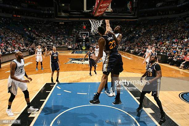 Rudy Gobert of the Utah Jazz blocks a shot against the Andrew Wiggins of the Minnesota Timberwolves on March 30 2015 at Target Center in Minneapolis...
