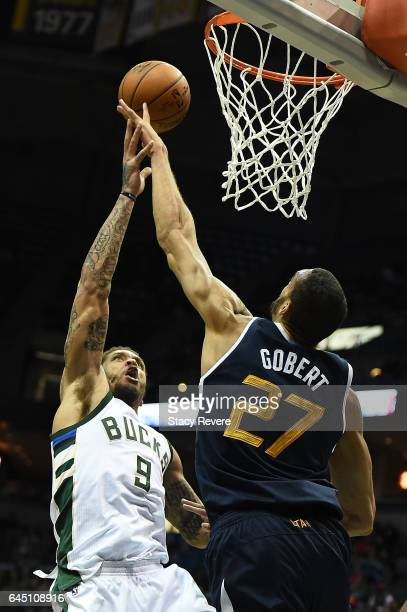 Rudy Gobert of the Utah Jazz blocks a shot by Michael Beasley of the Milwaukee Bucks during the second half of a game at the BMO Harris Bradley...
