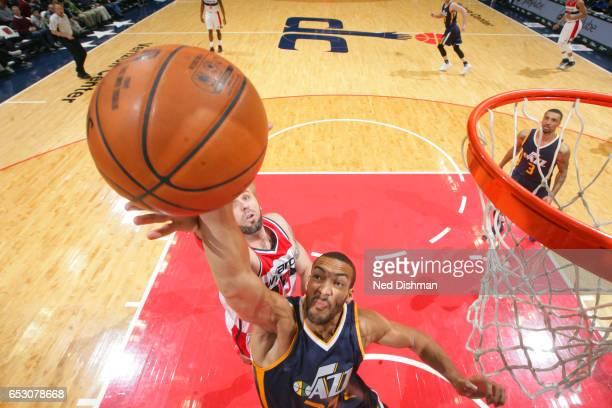 Rudy Gobert of the Utah Jazz blocks against Marcin Gortat of the Washington Wizards on February 26 2017 at Verizon Center in Washington DC NOTE TO...