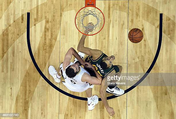 Rudy Gobert of the Utah Jazz blocks out Jeff Withey of the New Orleans Pelicans during the first half of a game at the Smoothie King Center on...