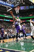 Rudy Gobert of the Utah Jazz blocks the shot of DeMarcus Cousins of the Sacramento Kings on January 14 2016 at vivintSmartHome Arena in Salt Lake...