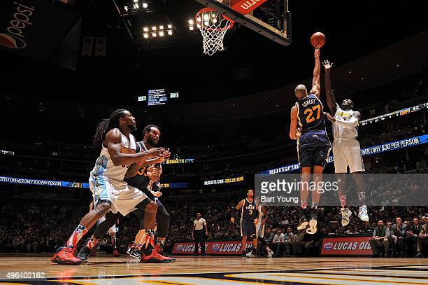 Rudy Gobert of the Utah Jazz blocks the shot of JJ Hickson of the Denver Nuggets on November 5 2015 at the Pepsi Center in Denver Colorado NOTE TO...