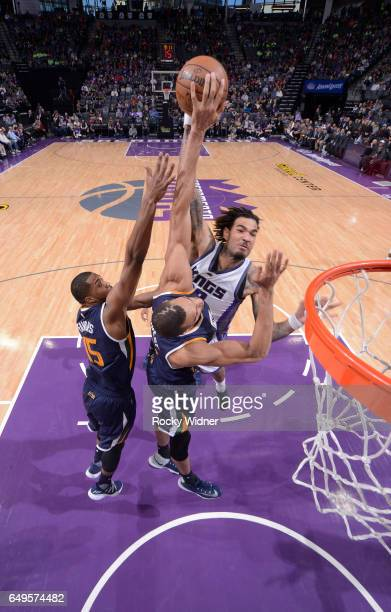 Rudy Gobert of the Utah Jazz blocks the shot of Willie CauleyStein of the Sacramento Kings on March 5 2017 at Golden 1 Center in Sacramento...