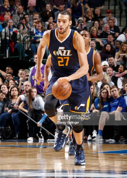 Rudy Gobert of the Utah Jazz brings the ball up court against the Dallas Mavericks on February 9 2017 at the American Airlines Center in Dallas Texas...