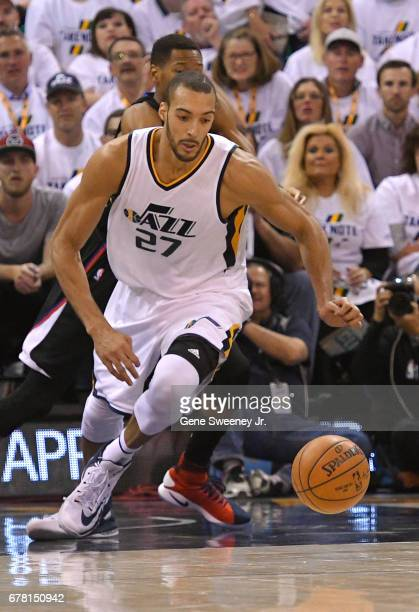 Rudy Gobert of the Utah Jazz chases a loose ball in the second half against the Los Angeles Clippers in Game Four of the Western Conference...