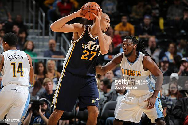 Rudy Gobert of the Utah Jazz controls the ball against Kenneth Faried of the Denver Nuggets at Pepsi Center on November 5 2015 in Denver Colorado The...
