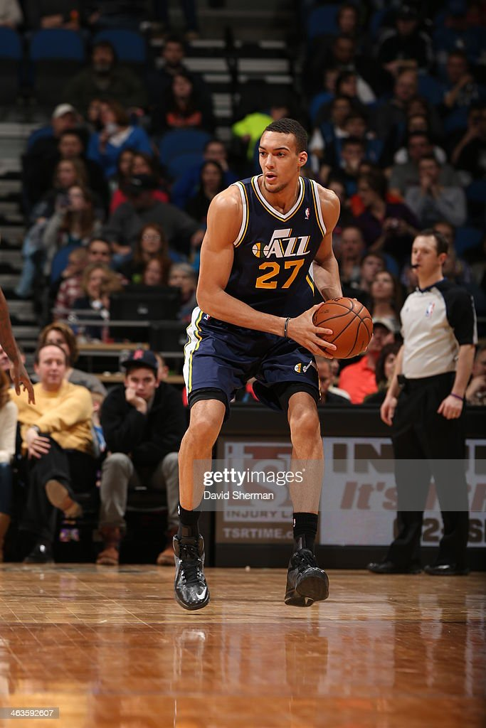 <a gi-track='captionPersonalityLinkClicked' href=/galleries/search?phrase=Rudy+Gobert&family=editorial&specificpeople=7616046 ng-click='$event.stopPropagation()'>Rudy Gobert</a> #27 of the Utah Jazz controls the ball against the Minnesota Timberwolves on January 18, 2014 at Target Center in Minneapolis, Minnesota.