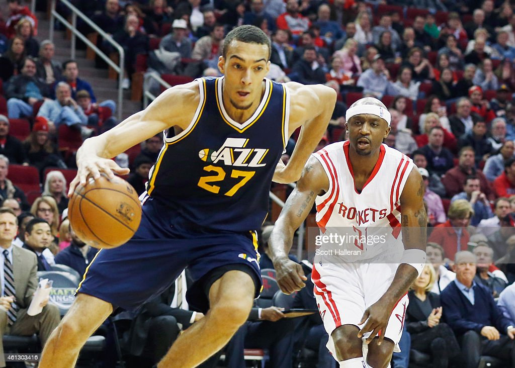 <a gi-track='captionPersonalityLinkClicked' href=/galleries/search?phrase=Rudy+Gobert&family=editorial&specificpeople=7616046 ng-click='$event.stopPropagation()'>Rudy Gobert</a> #27 of the Utah Jazz drives with the basketball in front of <a gi-track='captionPersonalityLinkClicked' href=/galleries/search?phrase=Jason+Terry&family=editorial&specificpeople=201734 ng-click='$event.stopPropagation()'>Jason Terry</a> #31 of the Houston Rockets during their game at the Toyota Center on January 10, 2015 in Houston, Texas.