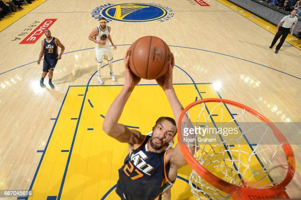 Rudy Gobert of the Utah Jazz dunks against the Golden State Warriors on April 10 2017 at ORACLE Arena in Oakland California NOTE TO USER User...