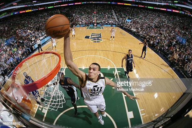 Rudy Gobert of the Utah Jazz dunks against the Memphis Grizzlies during the game on April 10 2015 at EnergySolutions Arena in Salt Lake City Utah...