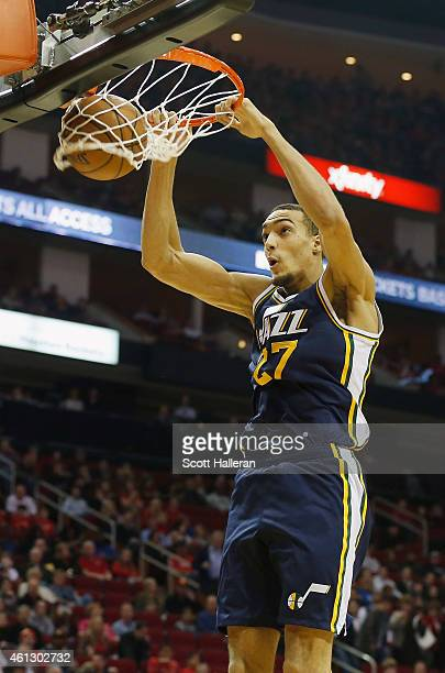 Rudy Gobert of the Utah Jazz dunks basketball against the Houston Rockets during their game at the Toyota Center on January 10 2015 in Houston Texas...