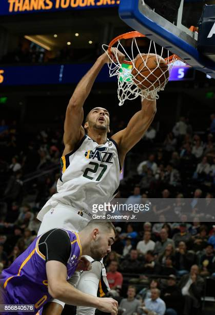 Rudy Gobert of the Utah Jazz dunks over Isaac Humphries of the Sydney Kings in the first half of their preseason game at Vivint Smart Home Arena on...