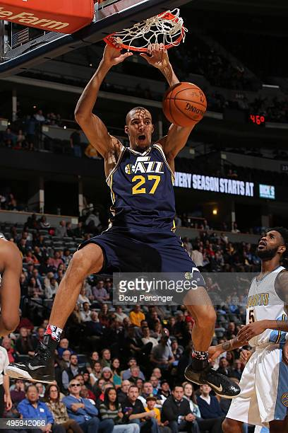 Rudy Gobert of the Utah Jazz dunks the ball against Will Barton of the Denver Nuggets at Pepsi Center on November 5 2015 in Denver Colorado The Jazz...