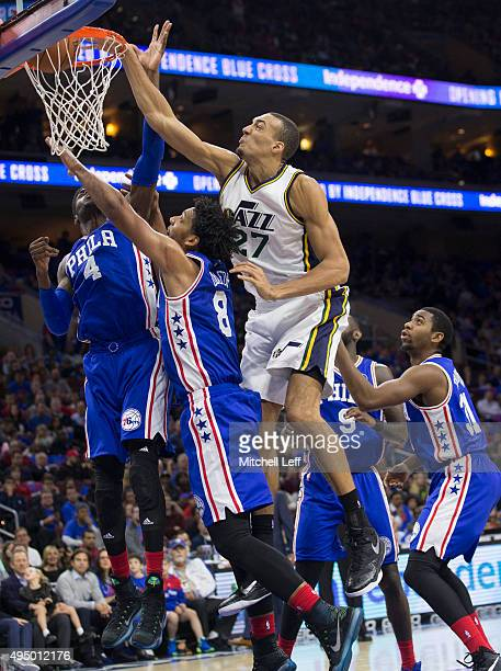 Rudy Gobert of the Utah Jazz dunks the ball over Nerlens Noel and Jahlil Okafor of the Philadelphia 76ers on October 30 2015 at the Wells Fargo...