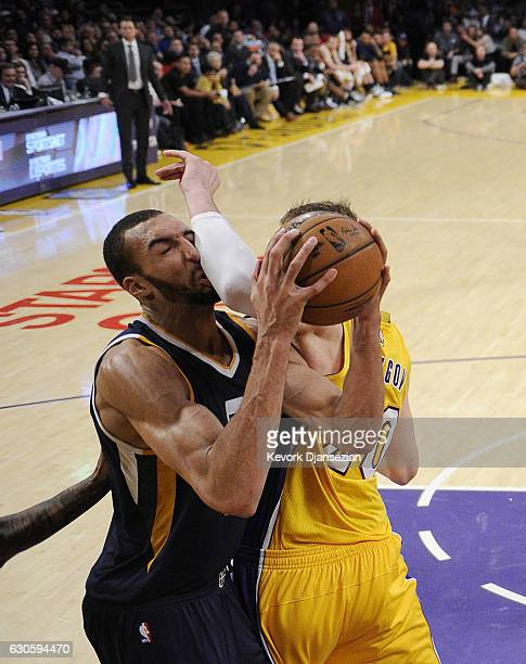 Rudy Gobert of the Utah Jazz gets an elbow from Timofey Mozgov of the Los Angeles Lakers during the first half of the basketball game at Staples...
