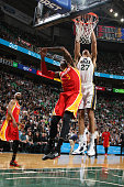 Rudy Gobert of the Utah Jazz goes to the basket against Josh Smith of the Houston Rockets on March 12 2015 at EnergySolutions Arena in Salt Lake City...