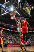 Rudy Gobert of the Utah Jazz goes to the basket against Terrence Jones of the Houston Rockets on March 12 2015 at EnergySolutions Arena in Salt Lake...