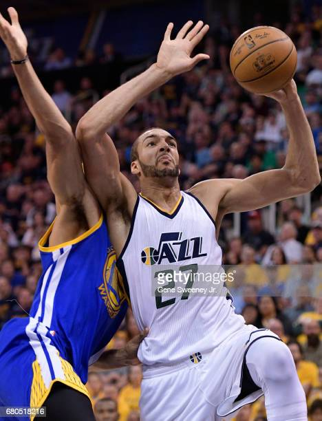 Rudy Gobert of the Utah Jazz goes to the basket in the first half past the defense of JaVale McGee of the Golden State Warriors in Game Four of the...