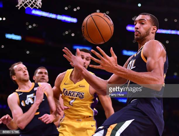 Rudy Gobert of the Utah Jazz grabs a rebound in front of Larry Nance Jr #7 of the Los Angeles Lakers and Joe Ingles during the first half at Staples...