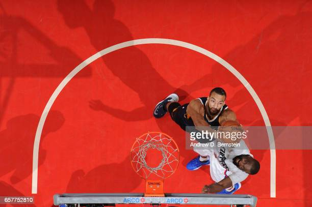Rudy Gobert of the Utah Jazz grabs the rebound during a game against the LA Clippers on March 25 2017 at STAPLES Center in Los Angeles California...