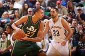 Rudy Gobert of the Utah Jazz handles the ball against Ryan Anderson of the New Orleans Pelicans on November 28 2015 at Vivint Smart Home Arena in...