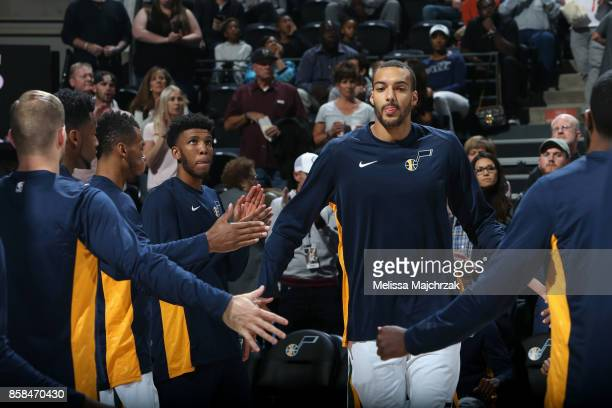 Rudy Gobert of the Utah Jazz high fives his teammates before the game against the Phoenix Suns on October 6 2017 at vivintSmartHome Arena in Salt...