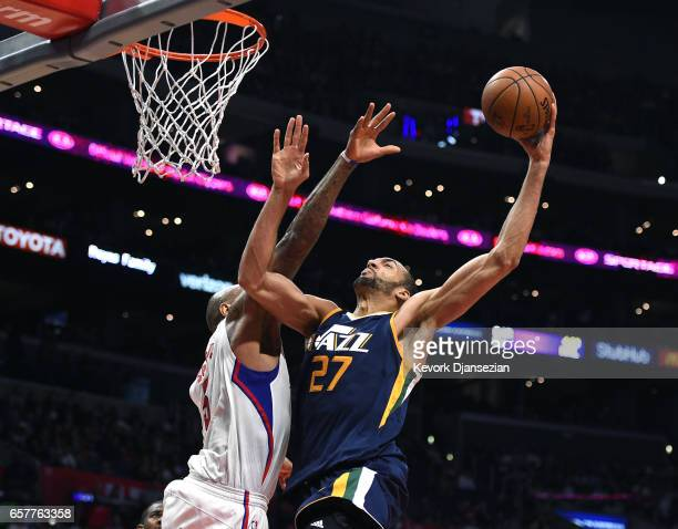 Rudy Gobert of the Utah Jazz is fouled by Marreese Speights of the Los Angeles Clippers as he goes up for a layup during the second half of the...