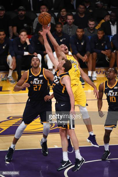 Rudy Gobert of the Utah Jazz Joe Ingles of the Utah Jazz and Larry Nance Jr #7 of the Los Angeles Lakers vie for the ball during the preseason game...